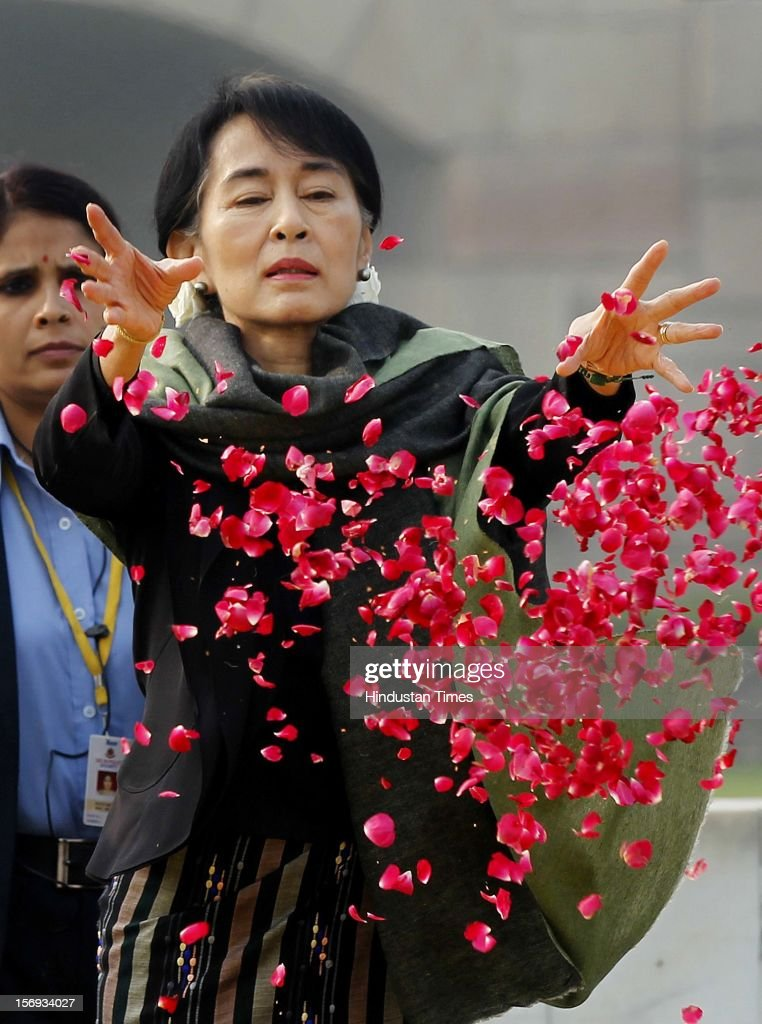 Chairperson of The National League for Democracy of Myanmar, Aung San Suu Kyi pays floral respects at Rajghat, the memorial of Mahatma Gandhi, on November 14, 2012 in New Delhi, India. Photo by Ajay Aggarwal/Hindustan Times