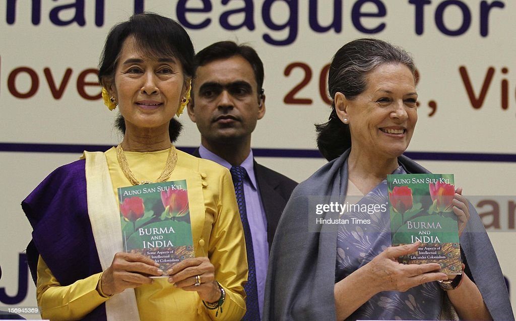 Chairperson of The National League for Democracy of Myanmar, Aung San Suu Kyi (L), and Chairperson of the Congress-led UPA government Sonia Gandhi pose with books signed by Suu Kyi during her Nehru Memorial Lecture on November 14, 2012 in New Delhi, India.