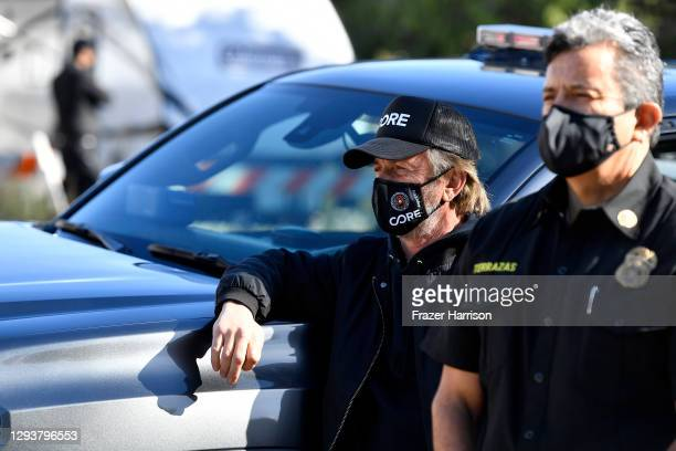 Chairperson Sean Penn and LAFD Chief Ralph Terrazas visit a coronavirus vaccination site at Lincoln Park on December 30, 2020 in Los Angeles,...