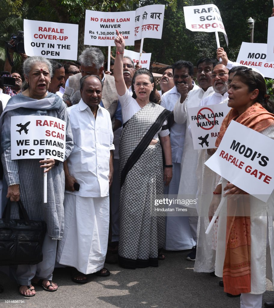 UPA chairperson Sonia Gandhi along with other opposition parties' leaders raises slogans during a protest against the Union government over Rafale deal issue, at Parliament House, on August 10,2018 in New Delhi, India.