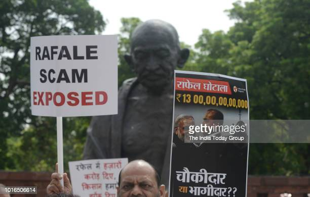 UPA chairperson Sonia Gandhi along with other opposition party leaders raises slogans during a protest against the Union government over Rafale deal...