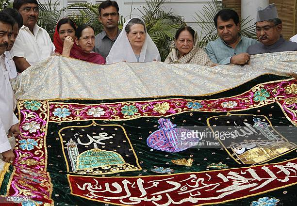 Chairperson Sonia Gandhi along with others holding a 'chadar' before sending it for the shrine of Khwaja Moinuddin Chishti during ongoing 801 Urs in...