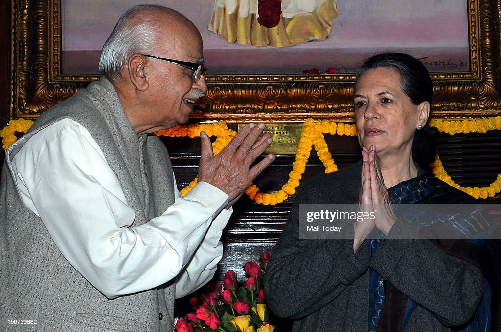 UPA Chairperson Sonia Gandhi and BJP senior leader L K Advani after paying tributes to the former Prime Minister Indira Gandhi on her 95th birth anniversary at Parliament House in New Delhi on Monday.