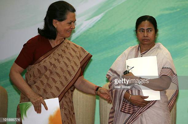 Chairperson Sonia Gandhi and Railways Minister Mamata Banerjee at the release of UPA's 'Report to The People' on completion of one year of UPA's...