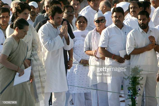 Chairperson Sonia Gandhi Congress General Secretary Rahul Gandhi and Priyanka Gandhi greet guests during the 19th death anniversary of former Prime...