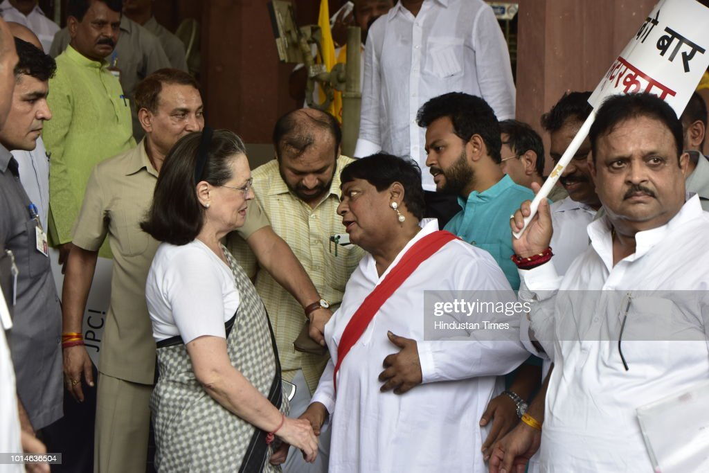 UPA chairperson Sonia Gandhi interacts with Telugu Desam Party (TDP) MP Naramalli Sivaprasad and other opposition parties' leaders during a protest against the Union government over Rafale deal issue, at Parliament House, on August 10, 2018 in New Delhi, India.