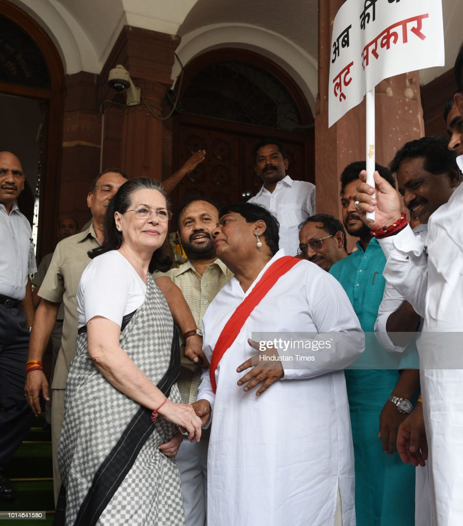 UPA chairperson Sonia Gandhi interacts with Telugu Desam Party (TDP) MP Naramalli Sivaprasad and other opposition parties' leaders during a protest against the Union government over Rafale deal issue, at Parliament House on August 10, 2018 in New Delhi, India.