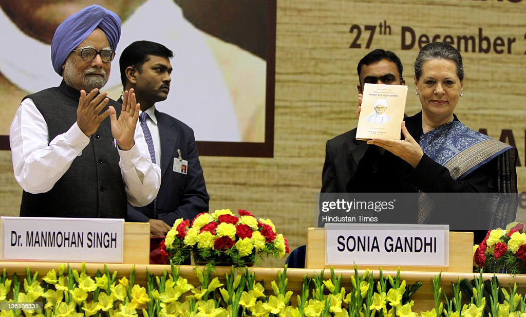 Chairperson Sonia Gandhi releases commemorative book on Mahamana Malaviya as Prime Minister Manmohan Singh looks on during a function to commemorate the 150th Birth Anniversary of Mahamana Madan Mohan Malaviya at Vigyan Bhawan on December 27, 2011 in New Delhi, India. A National Implementation Committee was formed under the chairmanship of Dr. Karan Singh to oversee the implementation of the various events aimed at promoting the ideals of Madan Mohan Malviya. Pandit Madan Mohan Malviya (1861-1946) was a prominent nationalist leader and served 4 times as the president of Indian National Congress. He also founded the Banaras Hindu University with Anne Besant.