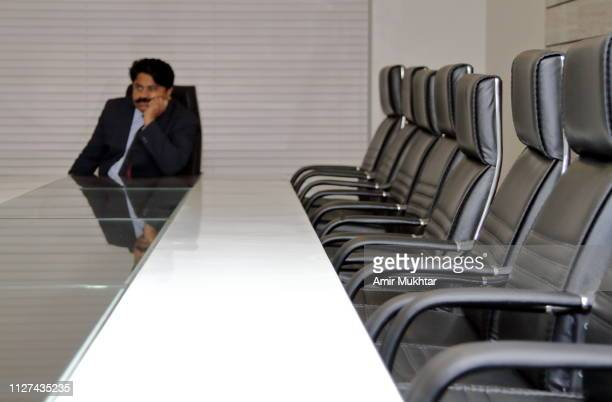 chairperson waiting for his colleagues in conference room in his office - punjab university stock pictures, royalty-free photos & images