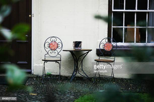 Chairs and a table are placed outside a home in Robin Hood's Bay on the North Yorkshire coast on March 8 2017 in Robin Hood's Bay United Kingdom...