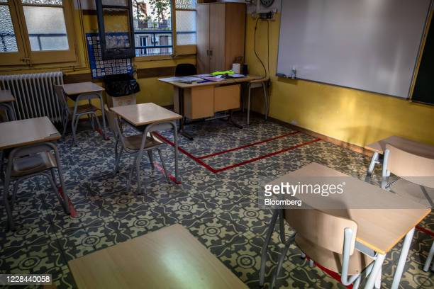 Chairs and desks sit behind social distancing markers on the floor inside the classroom of a school for ages 3 to 18 as it prepares to reopen in...