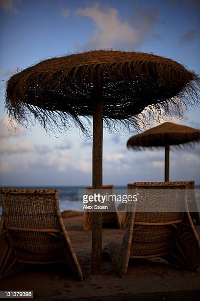 Chairs and palapa on beach