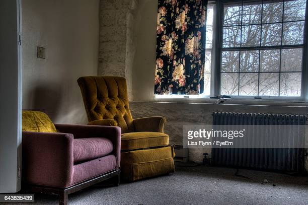 Chairs And Radiator In Abandoned House