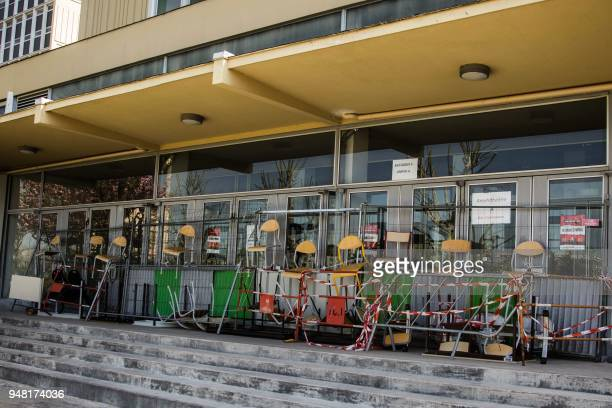 Chairs and safety barriers block access on the campus of the Nanterre University west of Paris on April 18 2018 during nationwide demonstrations of...