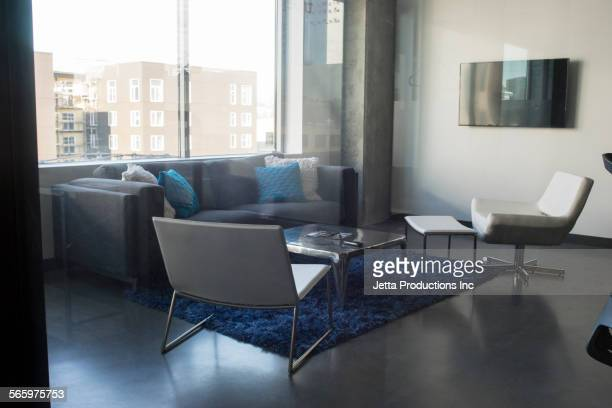 Chairs and sofa in office lounge