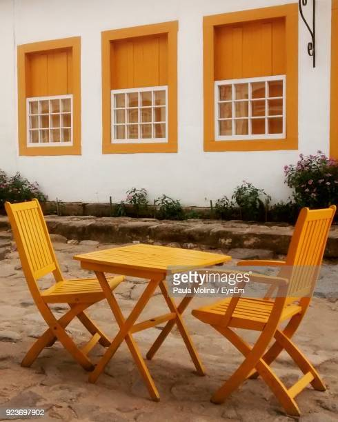 Chairs And Table Against House