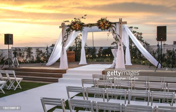 chairs and table against sky during sunset - sports venue stock pictures, royalty-free photos & images