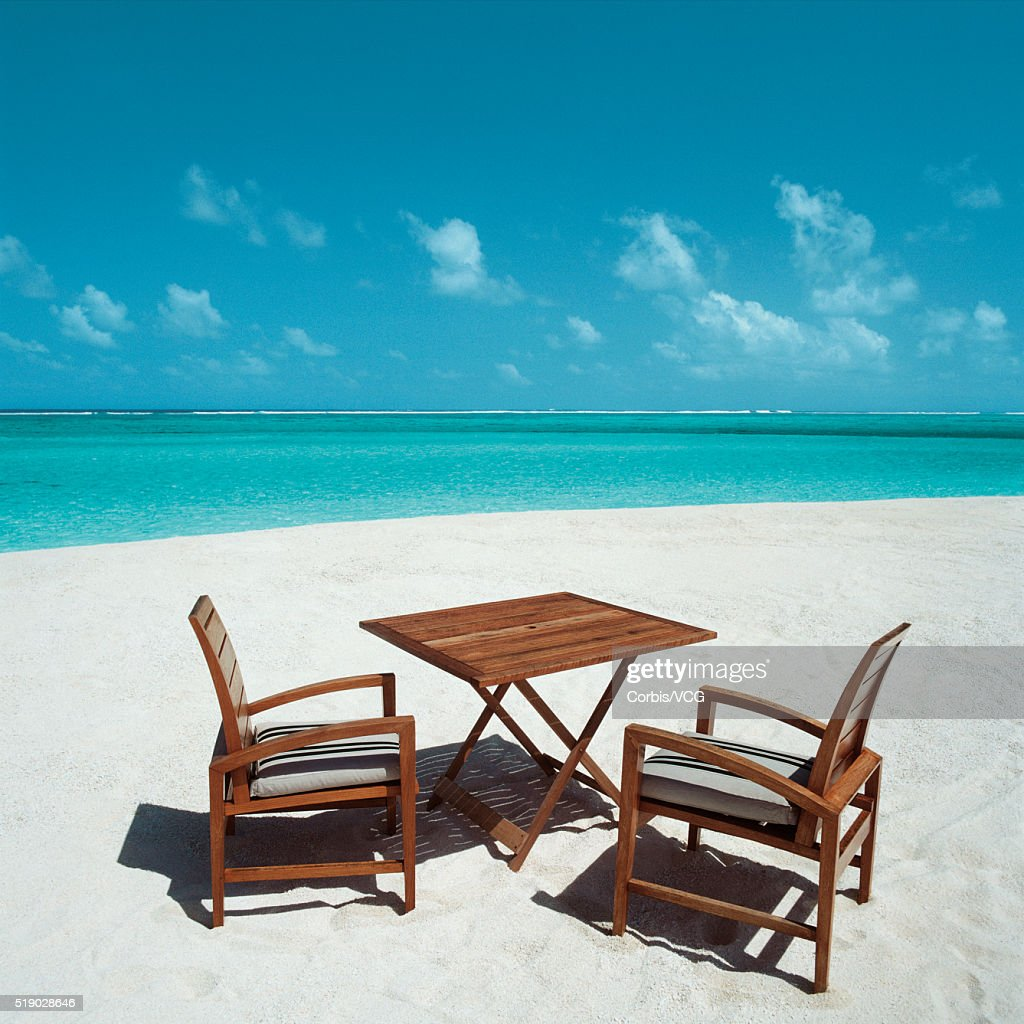 Chairs And Table At A Beach Photo