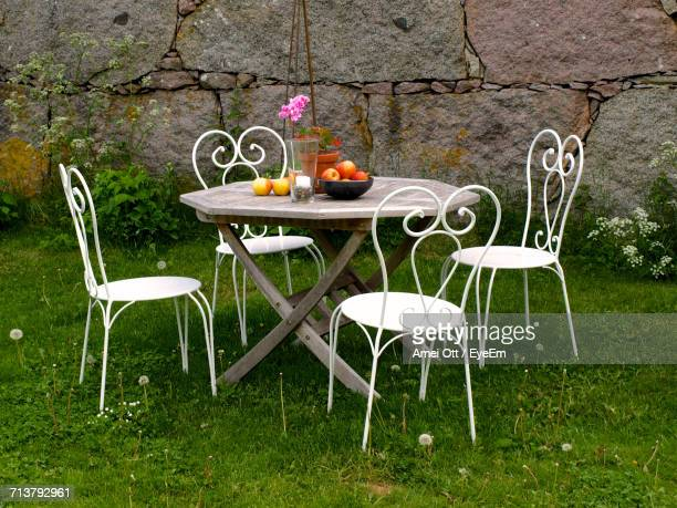 Chairs And Table By Plants