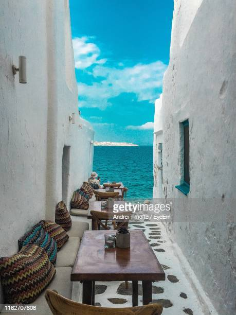 chairs and table by sea against sky - greece stock pictures, royalty-free photos & images