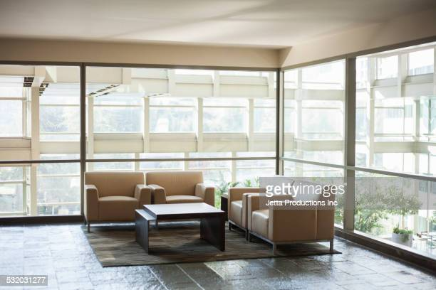 Chairs and table in office lobby