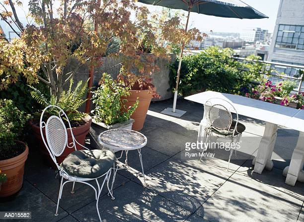 Chairs and Table on a Rooftop Garden Patio