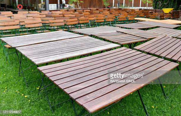 Chairs and tables are seen in a beer garden as the premises is being prepared for reopening in Salzburg, central Austria on April 28, 2020 amid the...
