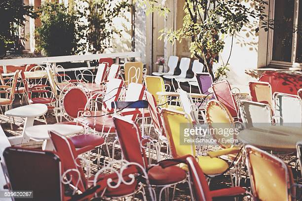 Chairs And Tables Arranged At Outdoor Cafe