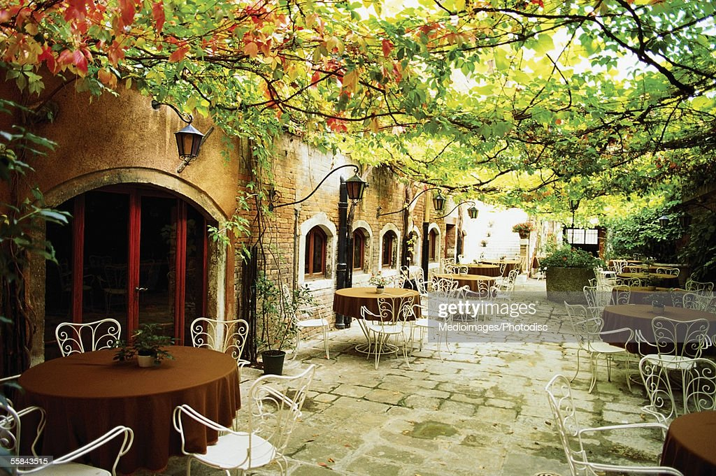 Chairs and tables in an outdoor restaurant, Venice, Italy : Stock Photo