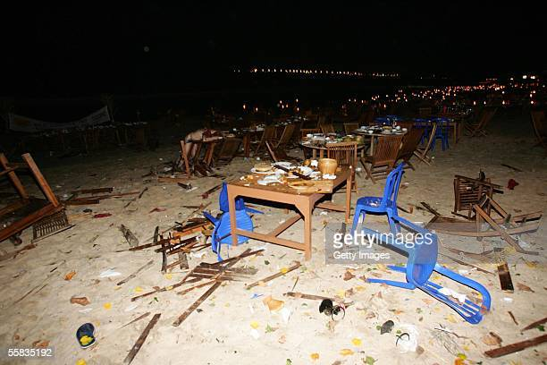 Chairs and tables lie on the ground at the Jimbaran Fish Cafes after a bomb blast on October 1 2005 in Bali Indonesia Several explosions were...