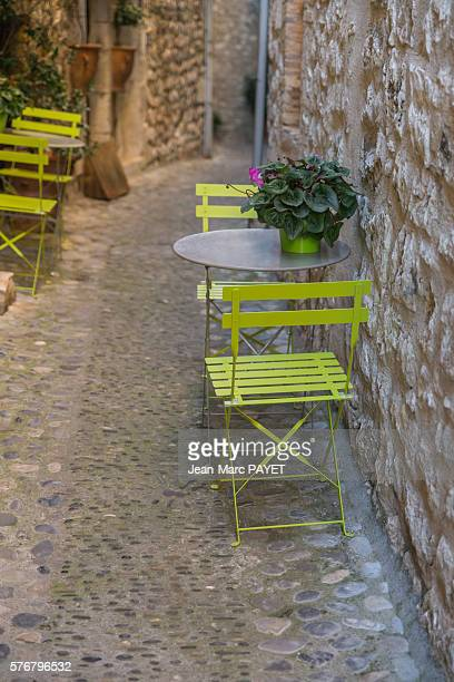 Chairs and tables on a typical village's street