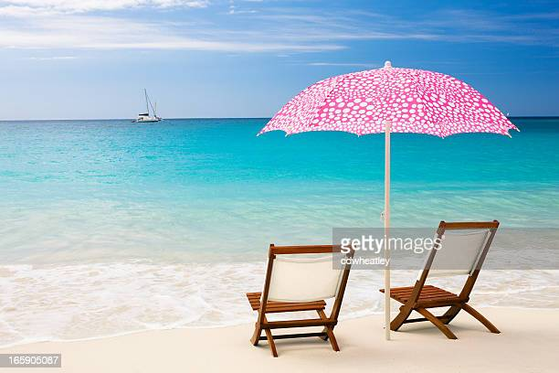 chairs and umbrella at a perfect beach in St. John