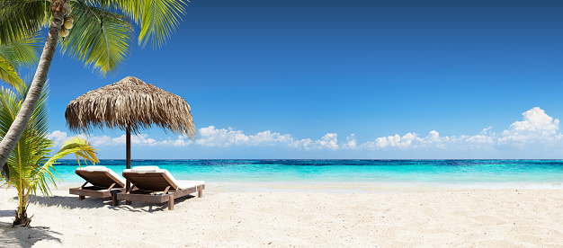 Chairs And Umbrella In Coral Beach - Tropical Resort Banner 638885650