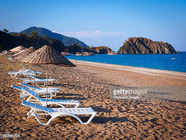 Chairs and umbrellas on sandy beach in Çirali
