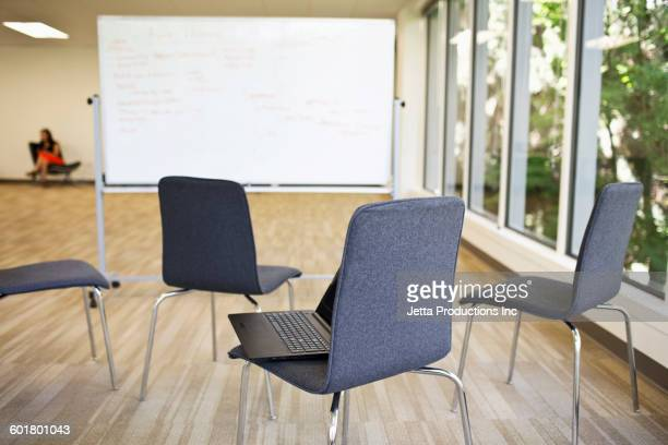 Chairs and whiteboard in empty office