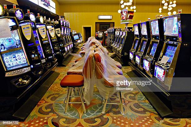 Chairs are covered with plastic in front of slot machines in Harrah's Entertainment Inc's Grand Casino in Biloxi Mississippi Tuesday August 8 2006 A...
