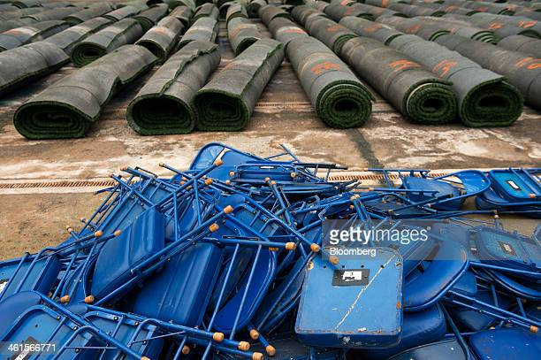 Chairs are piled up near rolls of synthetic turf during the demolition of the Hubert H Humphrey Metrodome in Minneapolis Minnesota US on Tuesday Jan...