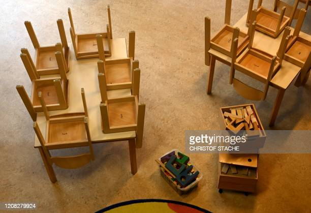 Chairs are placed on tables in a closed kindergarten in Eichenau, southern Germany, on March 26 as public life in Bavaria has been limited to combat...