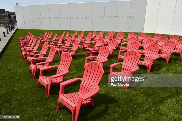 Chairs are positioned on the lawn of the Edward M Kennedy Institute one red chair for each Republican one blue for each Democrat and one green for...