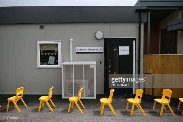 Chairs are positioned to separate classes in the playground in a teaching environment safe from Coronavirus for pupils and teachers at Brambles...