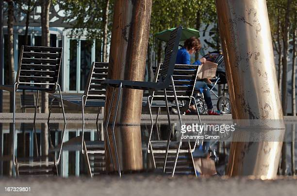 Chairs are reflected by water outside the Bregenz opera house during the roofing ceremony of Seebuehne on April 24, 2013 in Bregenz, Austria. The...