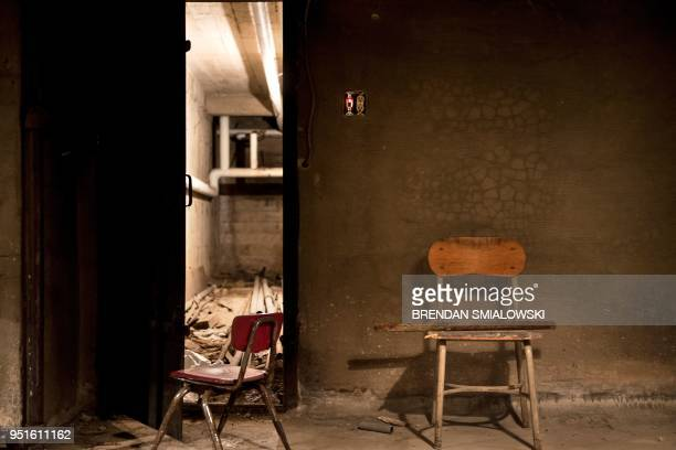 Chairs are seen discarded from the school above in a former Civil Defense fallout shelter beneath the OysterAdams School April 17 2018 in Washington...