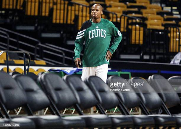 Chairs are set out for the photo shoot as injured Celtics guard Ray Allen comes onto the floor The Celtics players coaches owners and assorted other...