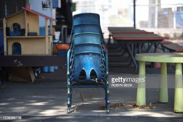 Chairs are stacked at a public elementary school campus in Los Angeles, California August 17, 2020 one day before the start of the new school year...