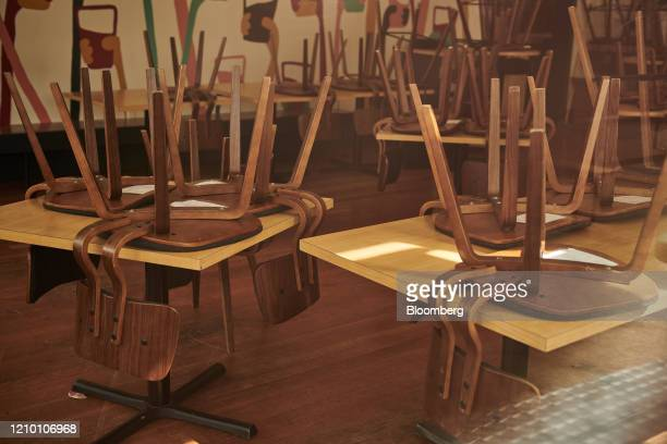 Chairs are stored on top of tables at a brewery closed in Sioux Falls South Dakota US on Wednesday April 15 2020 South Dakota Governor Kristi Noem...
