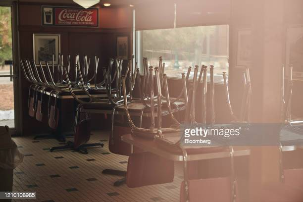 Chairs are stored on top of tables at a diner closed in Sioux Falls South Dakota US on Wednesday April 15 2020 South Dakota Governor Kristi Noem has...