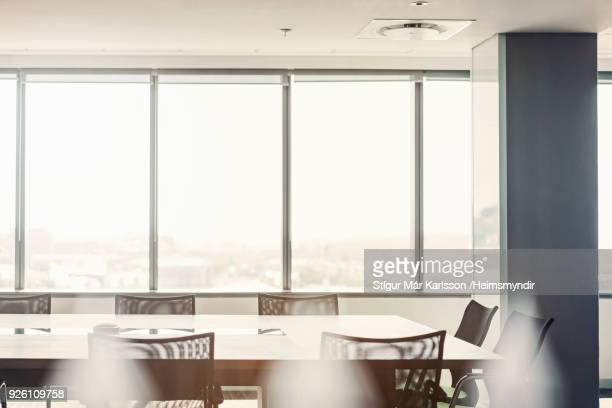 chairs arranged around conference table in office - focus on background stock pictures, royalty-free photos & images