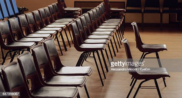 chairs arranged in room - alessandro miccoli stockfoto's en -beelden