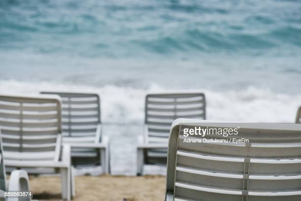 chairs at beach - adriana duduleanu stock photos and pictures