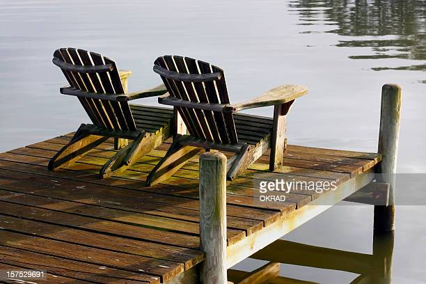 chairs at sunset on bay - chesapeake bay stock pictures, royalty-free photos & images